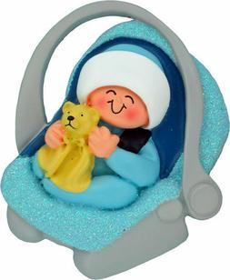 baby boy ornament in carrier car seat